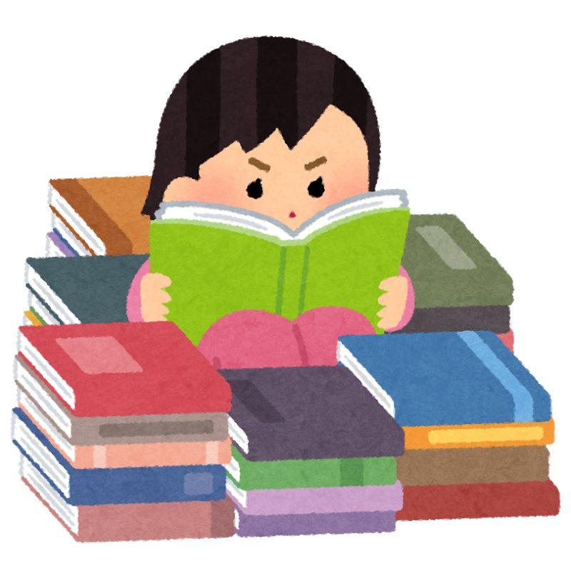 本に埋もれて読書する女の子